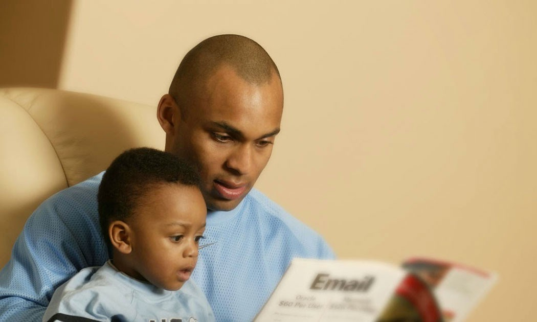 dad reading with child