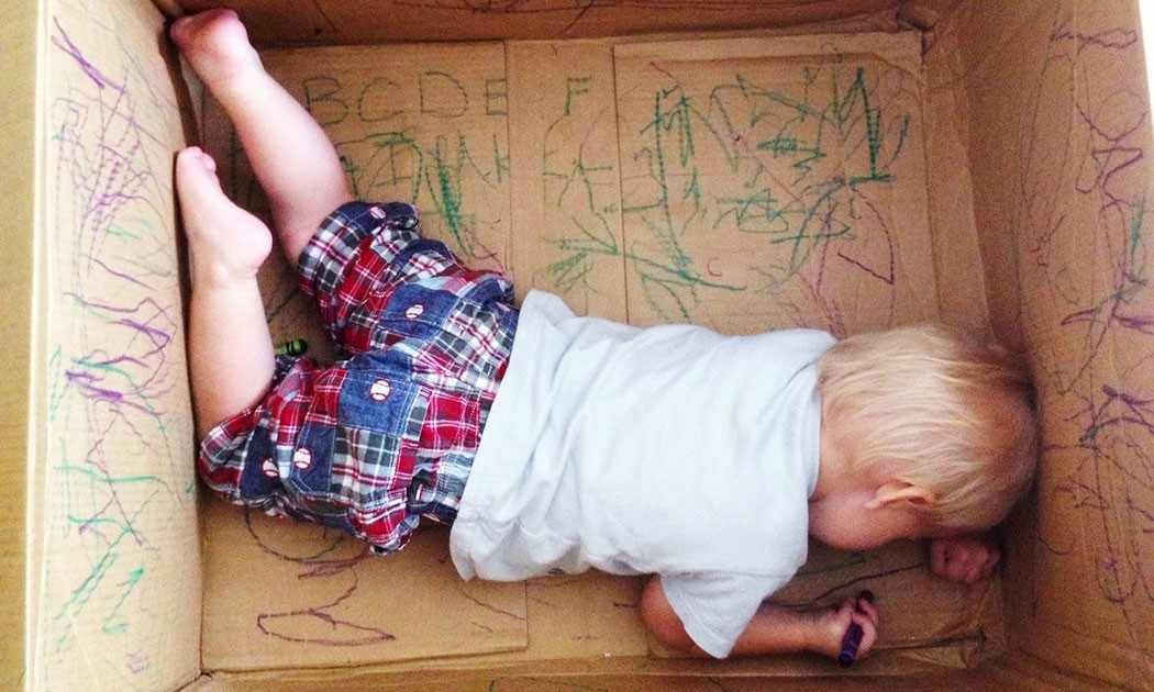 kid drawing in box