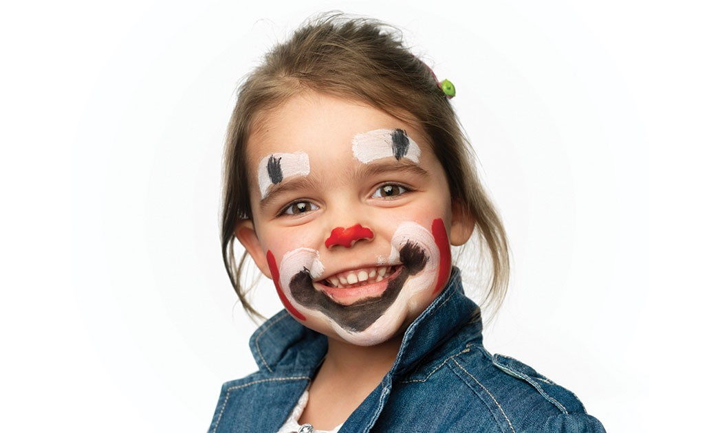 girl with clown face paint